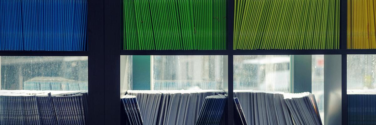 Folders on a shelf Photo byMaarten van den HeuvelonUnsplash